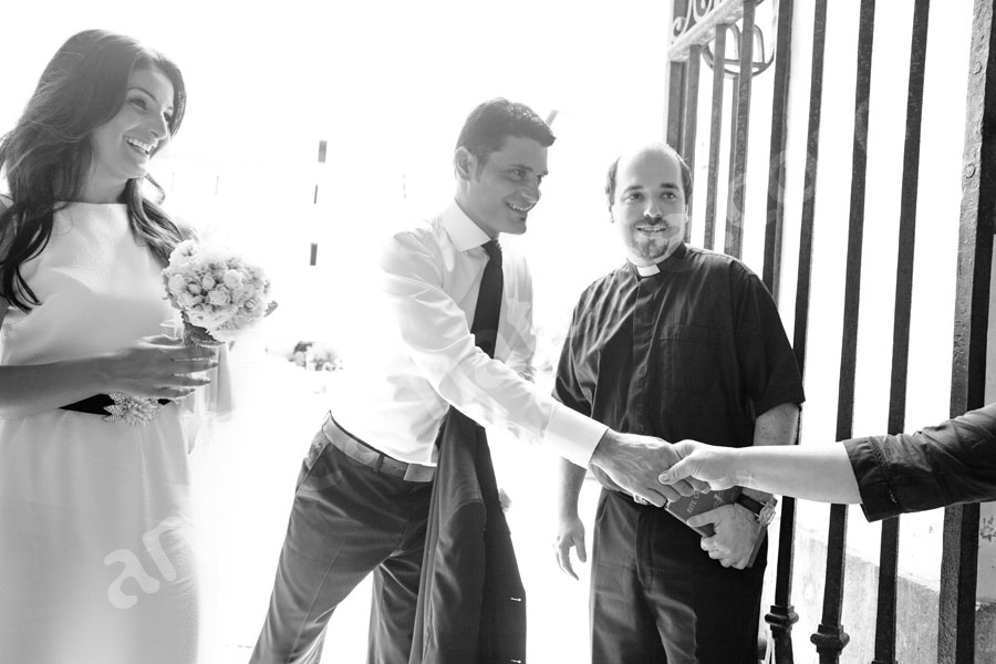 Groom shaking hands before the matrimony ceremony