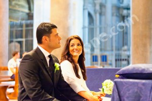 Bride smiling at the groom during the church wedding