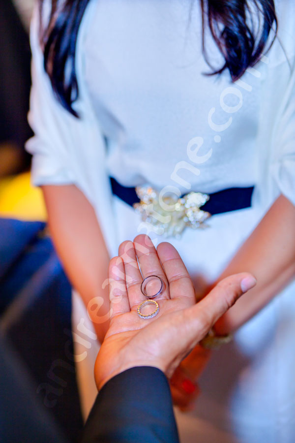 Groom holding the rings in the palm of the hand.