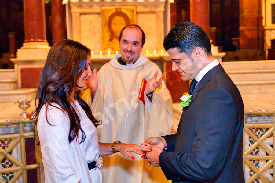 The exchange of the rings during a church ceremony.