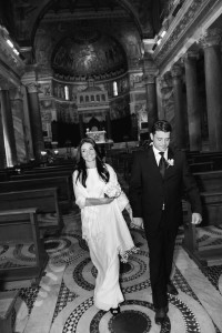 Bride and groom walking out of the church together in Rome
