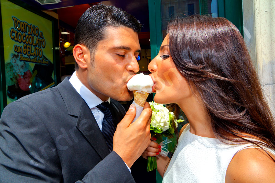Bride and groom eating ice cream together