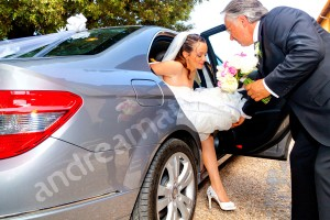 The bride stepping out of the car