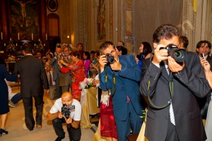 Guests taking pictures and photographing the entrance of the bride