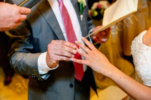Putting the wedding ring on during the ceremony