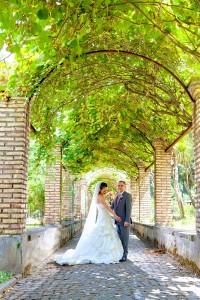 The wedding bride and groom inside the courtyard inside Convent Frati dei Capuccini