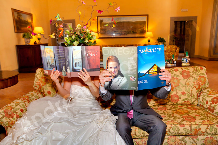 Bride and groom reading magazines