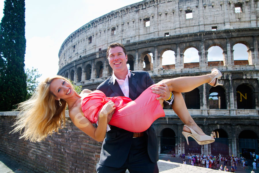 Holding girl female woman by the Coliseum. Engagement Photography Rome. Shouldn't it be fun and creative!?