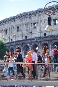 Couple photographed among passing by tourists in Rome Italy before the Coliseum