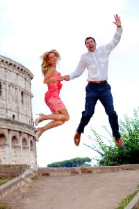 Jumping high up in the air with the Colosseum as a background