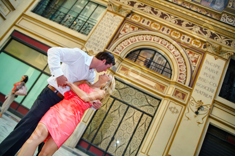 Kissing and dancing during an engagement photo session