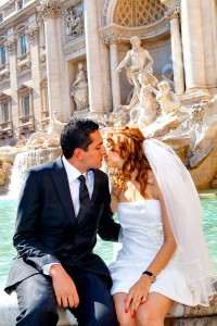 Wedding kiss in front of Fontana di Trevi fountain in Rome Italy