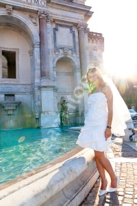 The bride photographed by the water fountain Fontanone by Gianicolo