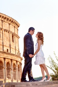 A romantic couple at sunset by the Roman Coliseum