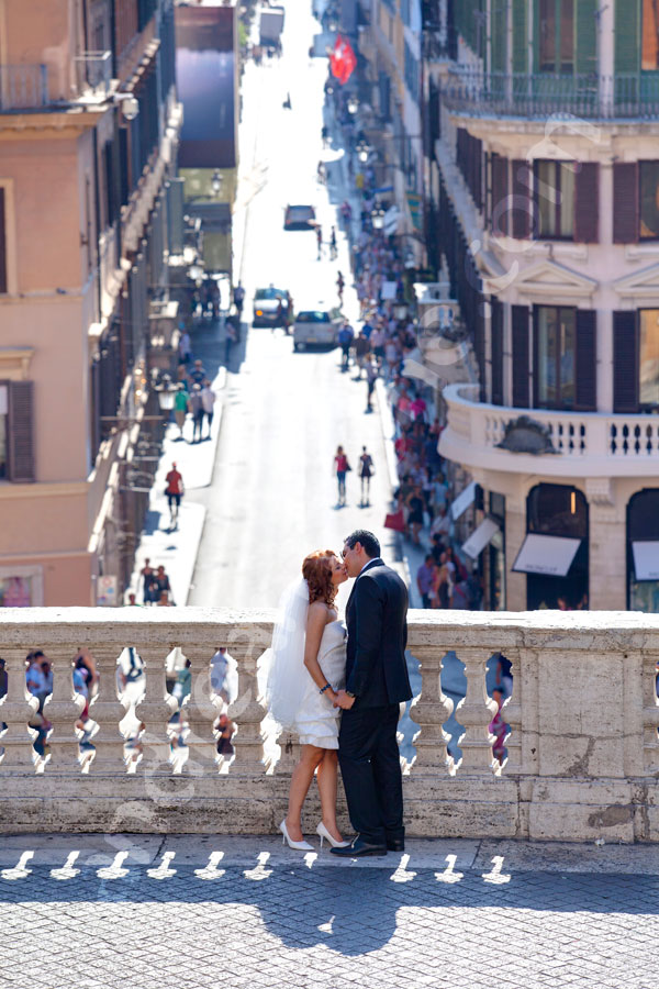 Tender kiss at Piazza di Spagna Spanish steps. Nice view over via Condotti.