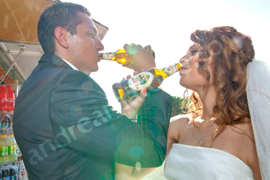 Wedding couple drinking Birra moretti beer