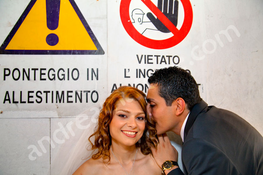 The bride and groom behind Italian construction signs