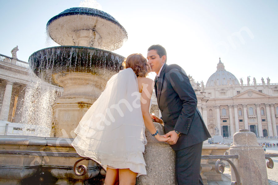 Kissing in the Vatican in Rome Italy by a water fountain
