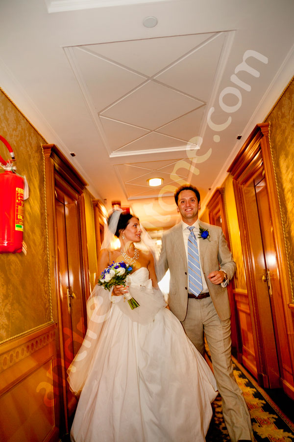 Newlyweds walking together in a hotel corridor heading to get married