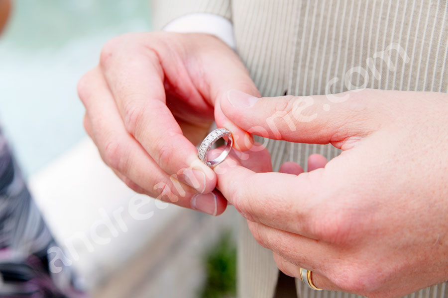 The groom holding the wedding ring