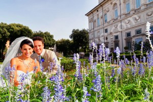 Bride and groom photographed among lavanda behind Museum Villa Borghese