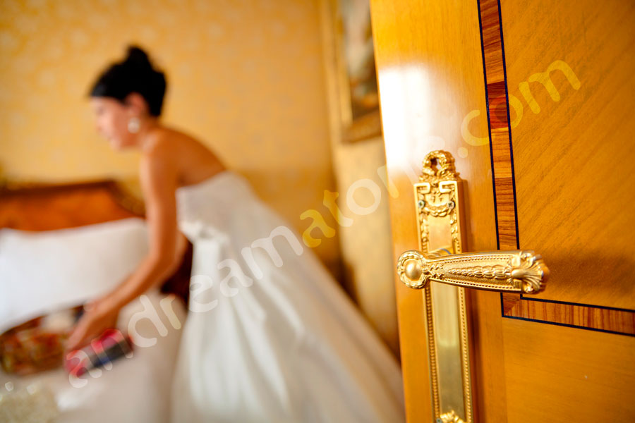 Door handle and the bride getting ready to exit