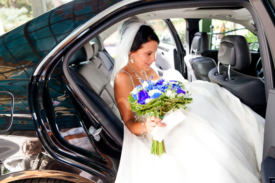 The bride entering the car