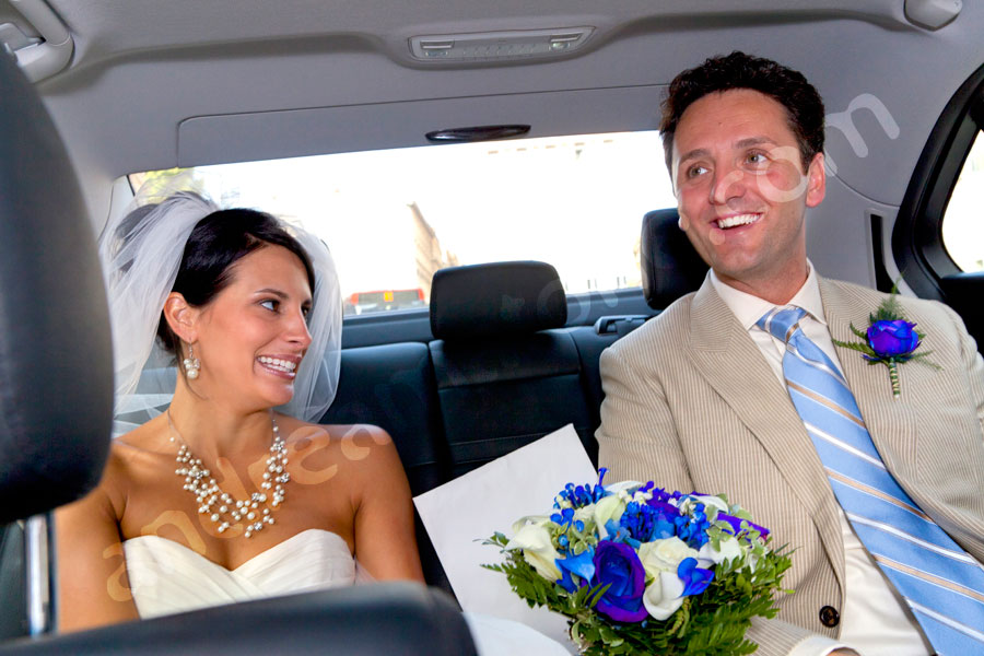 Happily inside the wedding car