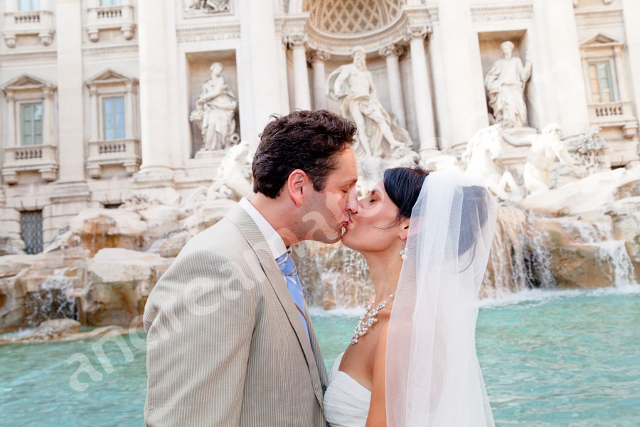 Man and woman just married kissing at Fontana di Trevi