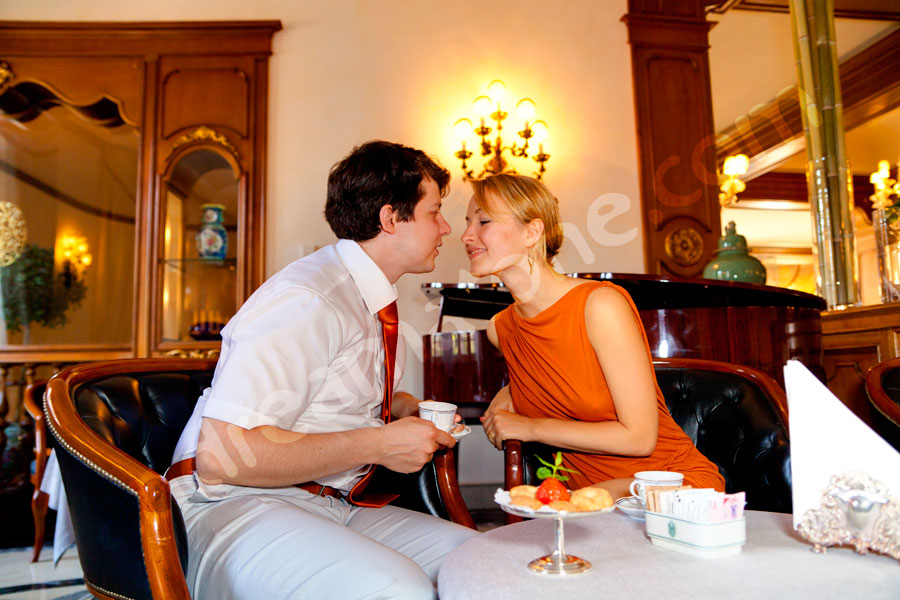 Couple kissing at a breakfast hall in a hotel