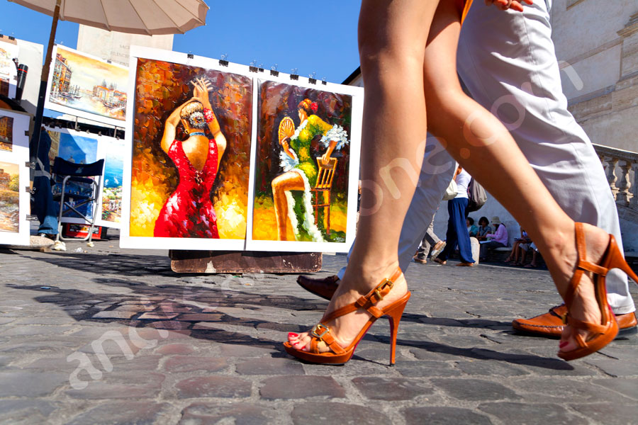 Woman's legs walking in the streets of Rome accompanied. Travel Vacation Photography in Rome Italy.