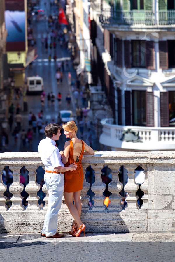 A couple in love standing on the terrace of Piazza di Spagna