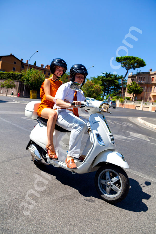 Riding a Vespa moped in Rome like in the Roman Holiday movie film (Vancanze Romane)