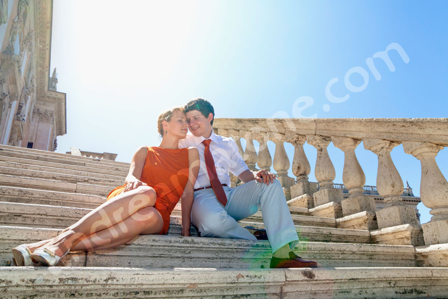 Couple in love sitting on stairs in Rome Italy