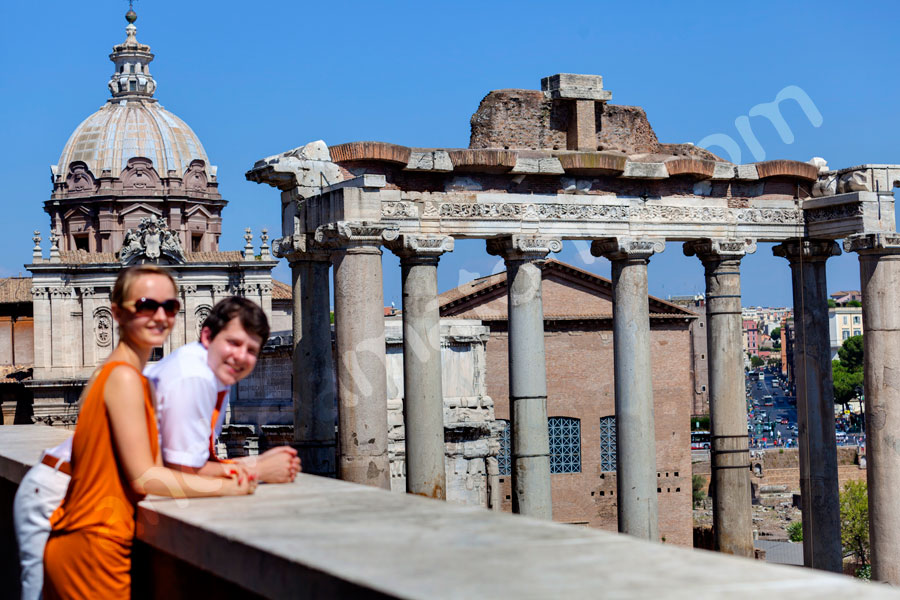 Couple standing by the Roman Forum. Observing the great view.