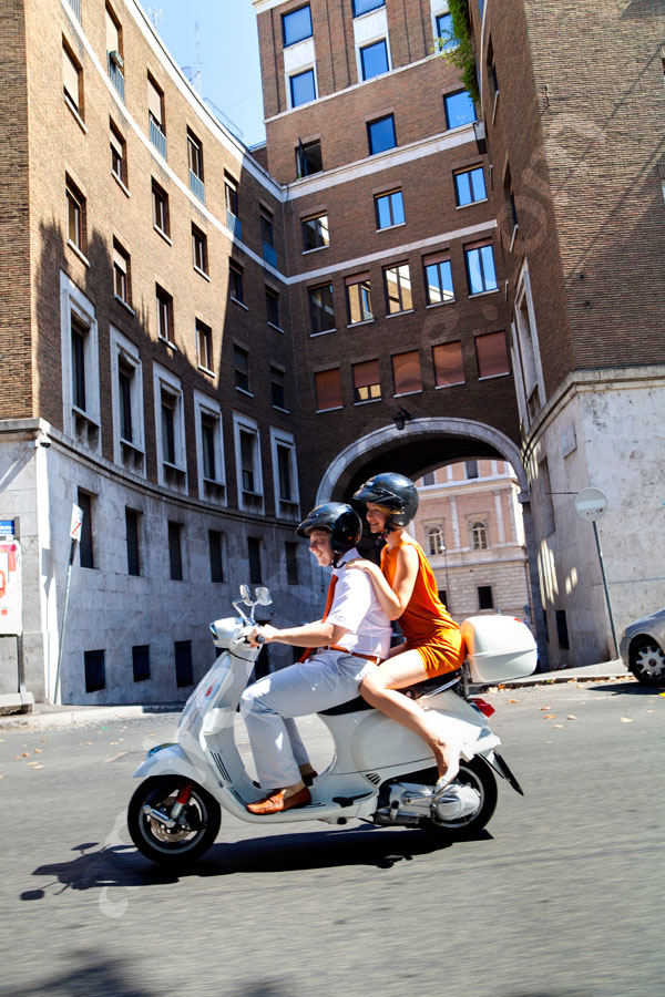 Riding on a vespa scooter through the city of Rome as a tribute to the Roman Holiday movie