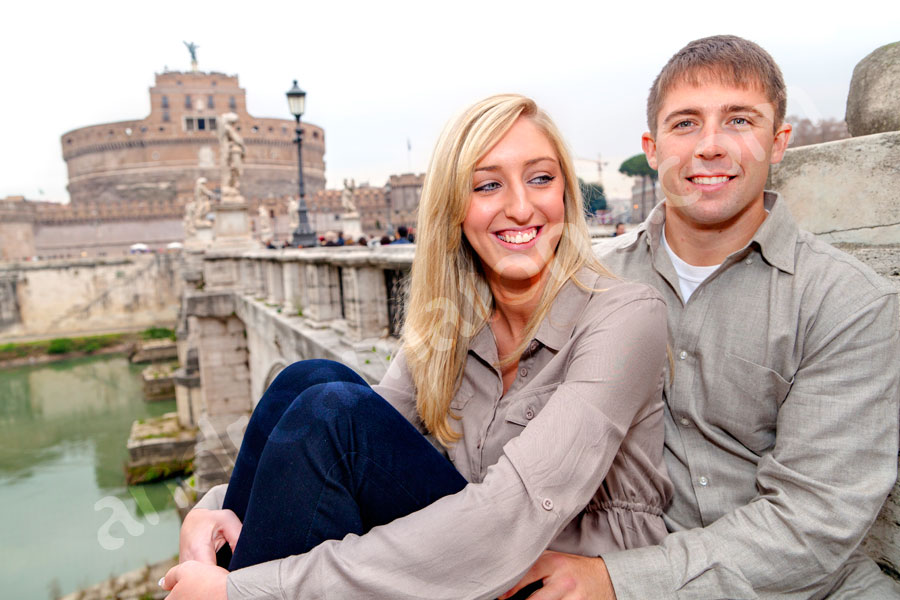 Couple together on bridge Castel Sant'Angelo during a photography session.