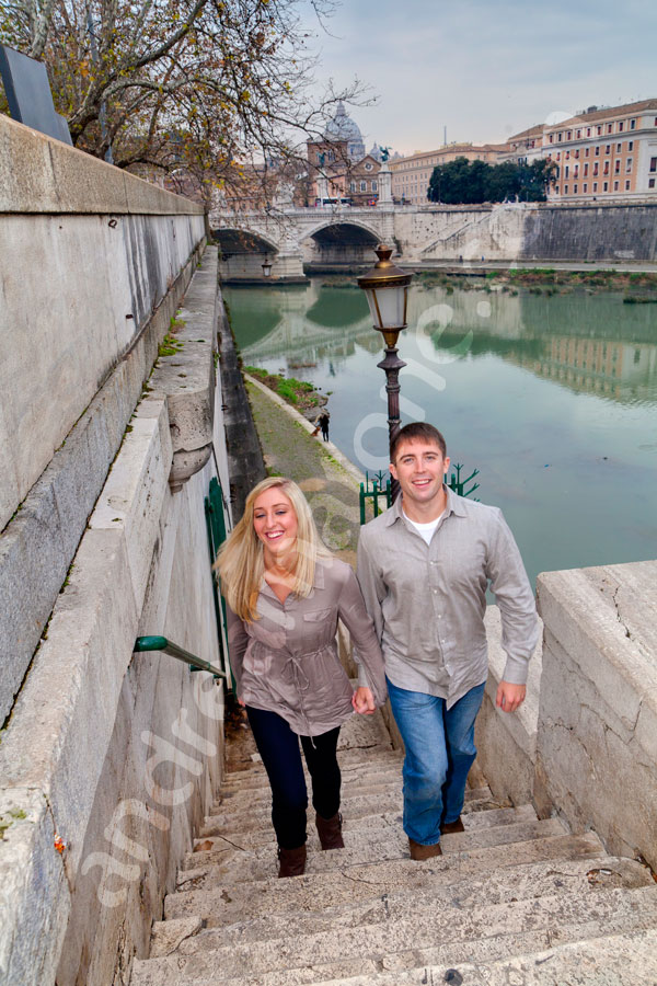 Couple walking up the stairs from the Tiber river.