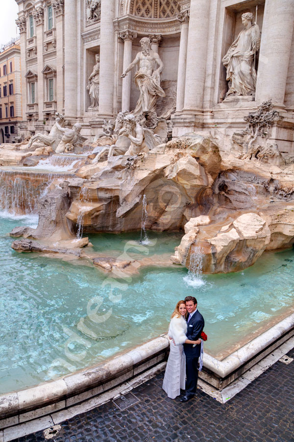 Bride and groom photographed from above piazza at Fontana di Trevi
