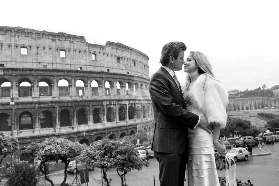 Bride and groom kissing at the Roman Colosseum Rome Italy