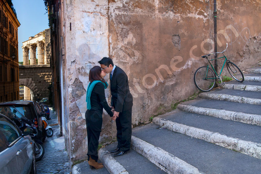 Kissing in the streets of Rome where ancient meets less ancient