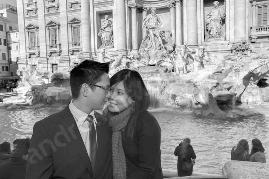 Romantic engagement couple together at the Trevi fountain