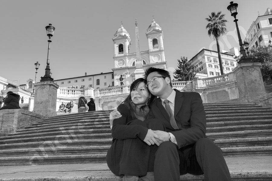 Black and white picture sitting on the stairs of Piazza di Spagna