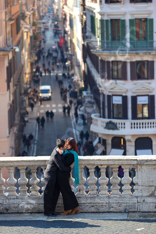 Kissing in Piazza di Spagna. Romantically in love in the eternal city of Rome.