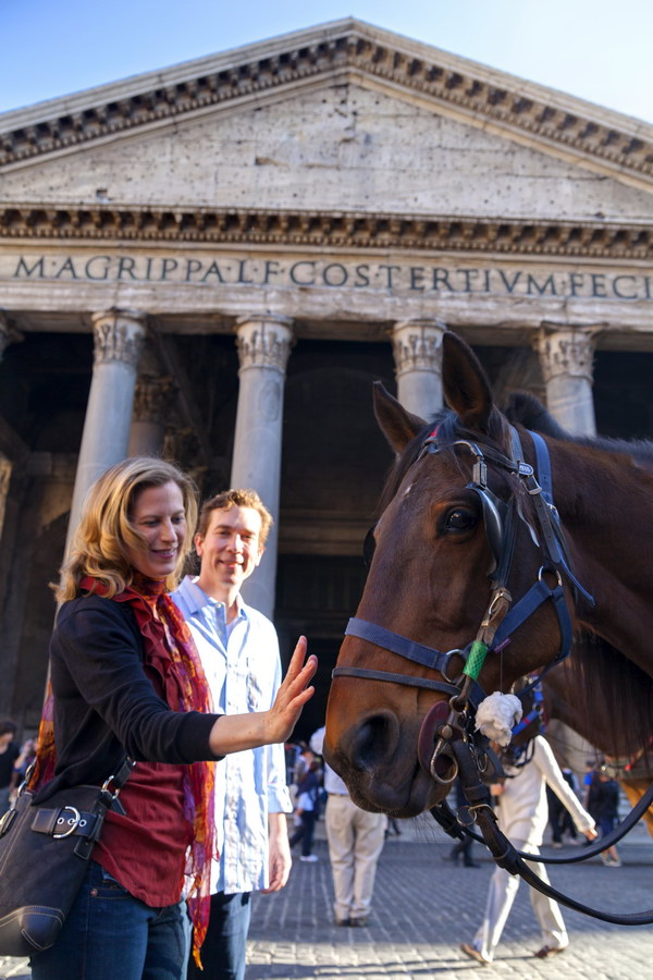 Caressing a horse in Piazza del Pantheon in Italy