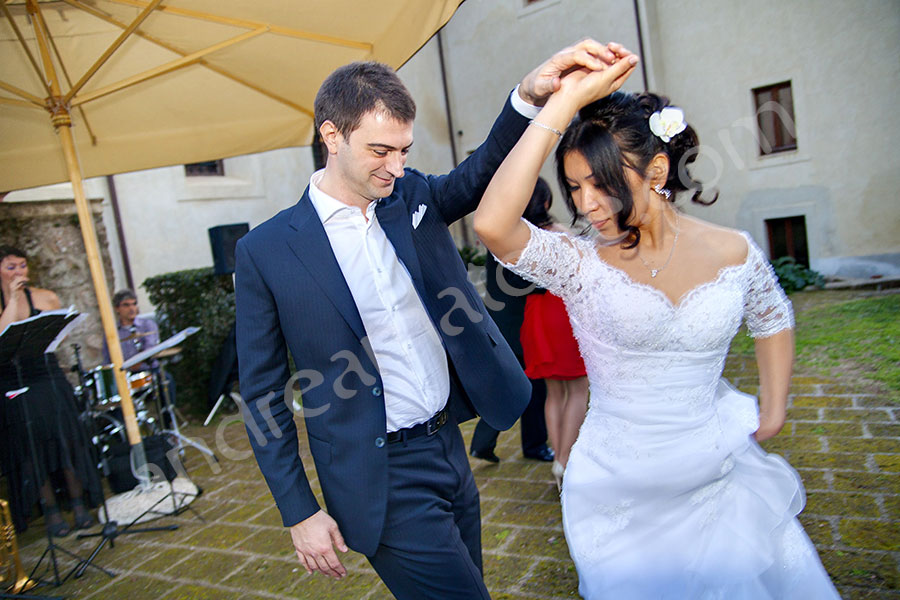 newlyweds dancing together to live music