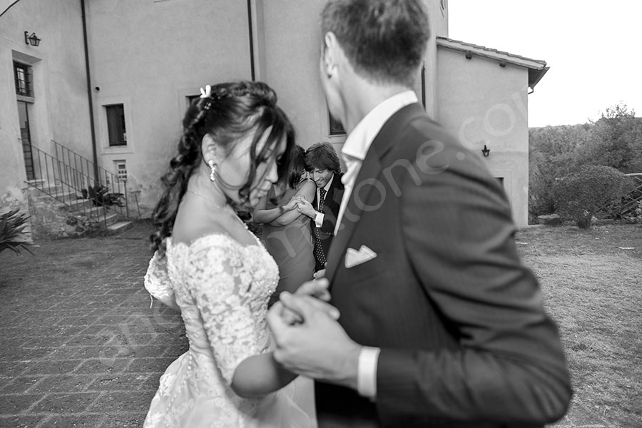 Bride and groom dancing together in black and white pictures