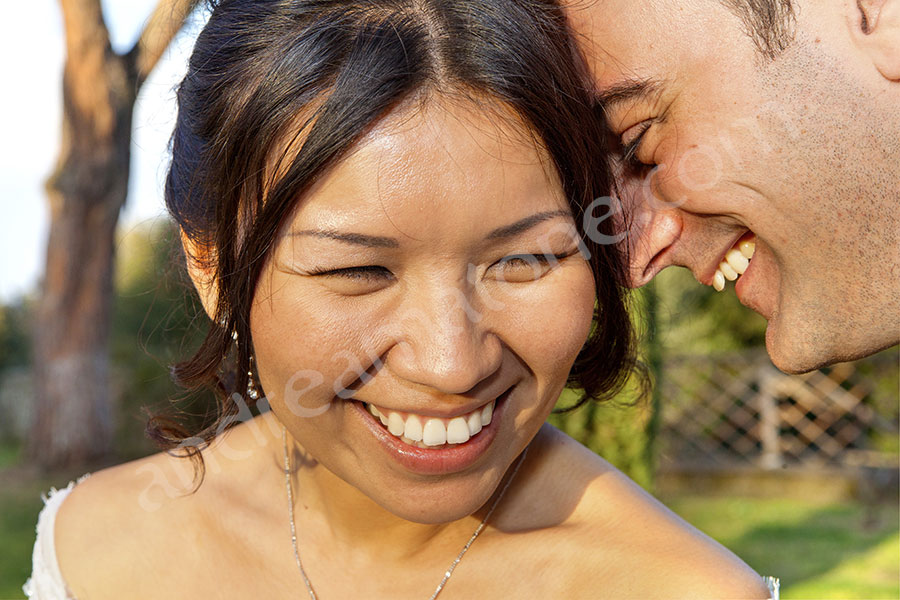 Close up bride and groom face portrait smiling