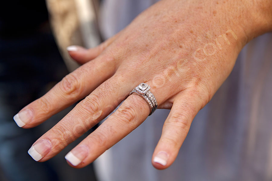 The engaged wedding ring on the hand and finger