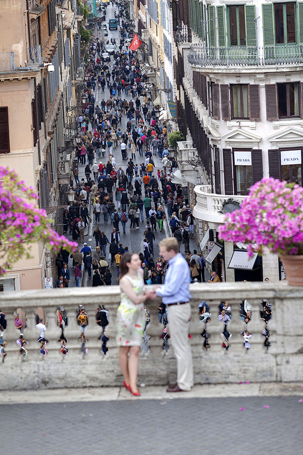 Engagement session in Piazza di Spagna with the view from via Condotti in the far distance